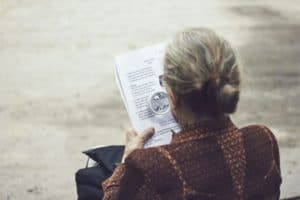 Person Reading with Magnifying Glass - What is Presbyopia